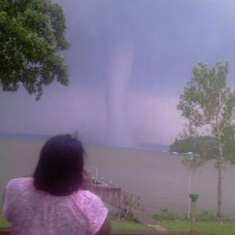 Photo - A white funnel cloud is spotted on Grand Lake near Cleora. Photo provided by Colby Jones