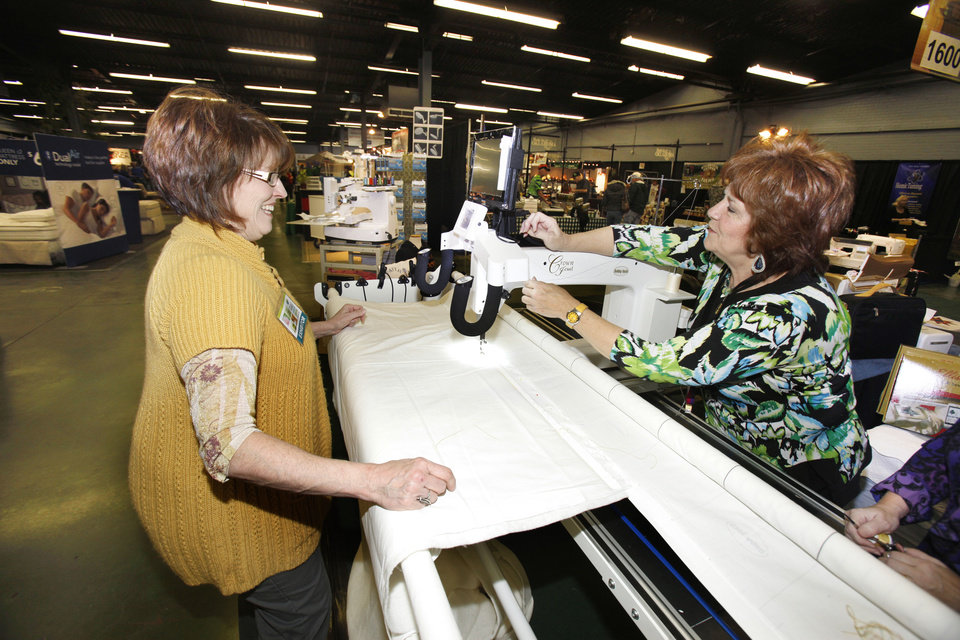 Susan Cave (left) and Joan Litchfield set up a long arm quilter during the Home and Garden Show at State Fair Park in Oklahoma City, OK, Friday, Jan. 20, 2012. By Paul Hellstern, The Oklahoman