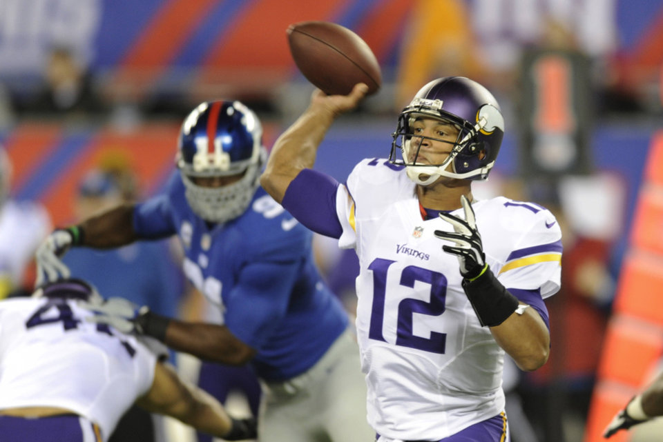 Josh Freeman, right, struggled in his first outing as the Vikings� quarterback. AP photo