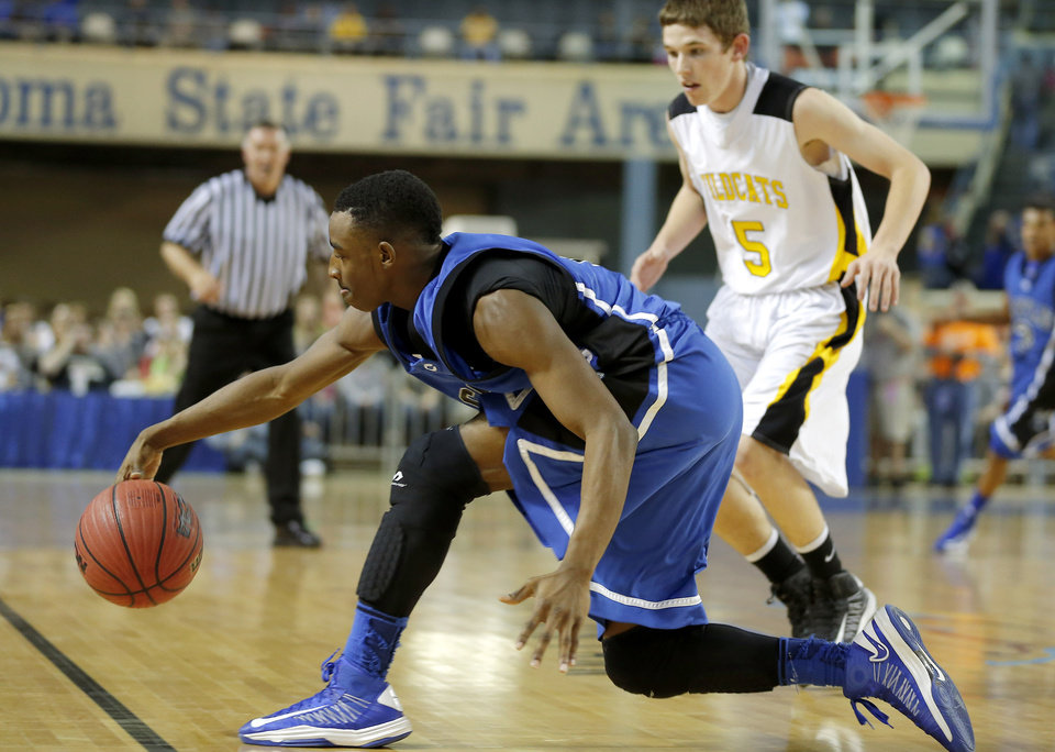 Photo - Coyle's Eric Harris reaches for the ball in front of Arnett's Ryne Friesen during the Class B boys state championship game between Coyle and Arnett in the State Fair Arena at State Fair Park in Oklahoma City, Saturday, March 2, 2013. Photo by Bryan Terry, The Oklahoman