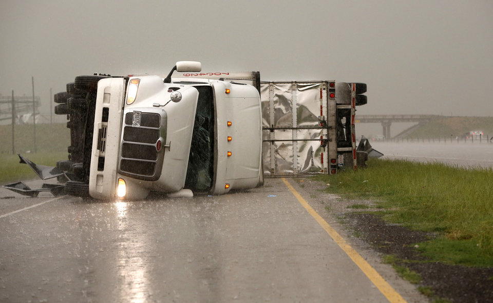 Overturned trucks block a frontage road off I-40 just east of 81 in El Reno, Okla., after a tornado moved through the area on Friday, May 31, 2013. (AP Photo/The Oklahoman, Jim Beckel) LOCAL STATIONS OUT (KFOR, KOCO, KWTV, KOKH, KAUT OUT); LOCAL WEBSITES OUT; LOCAL PRINT OUT (EDMOND SUN OUT, OKLAHOMA GAZETTE OUT) TABLOIDS OUT