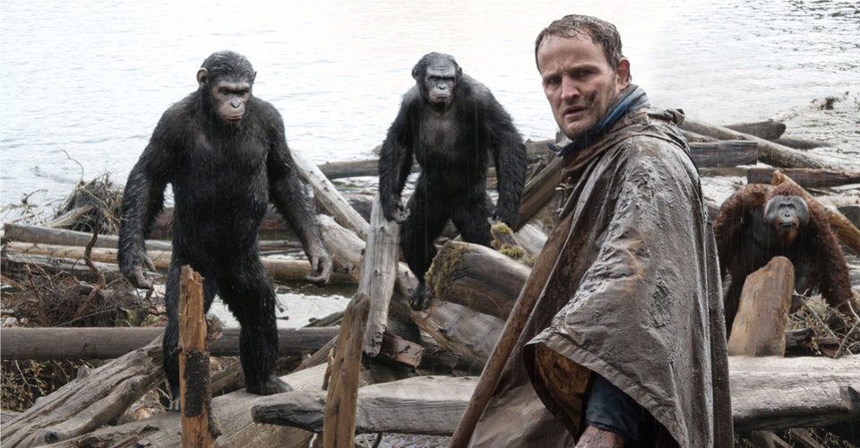 """Photo -  This photo shows Jason Clarke, as Malcolm, foreground, and, background from left, Andy Serkis, as Caesar; Toby Kebbell, as Koba; and Karin Konoval, as Maurice; in a scene from """"Dawn of the Planet of the Apes."""" AP Photo    -"""