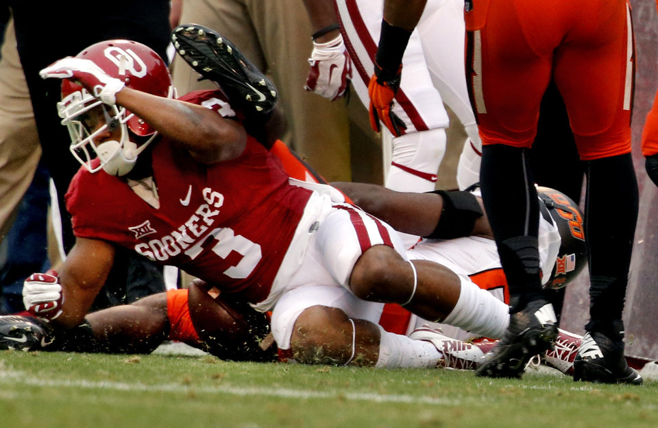 Photo - Sooner's Sterling Shepard (3) is injured on a pass play during a Bedlam college football game between the University of Oklahoma Sooners (OU) and the Oklahoma State Cowboys (OSU) at Gaylord Family-Oklahoma Memorial Stadium in Norman, Okla., on Saturday, Dec. 6, 2014. Photo by Steve Sisney, The Oklahoman