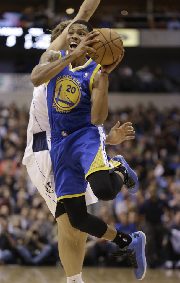 Golden State Warriors guard Kent Bazemore (20) looks to pass after colliding with Dallas Mavericks forward Dirk Nowitzki (41) of Germany during the first quarter of an NBA basketball game Saturday, Feb. 9, 2013, in Dallas. (AP Photo/LM Otero)