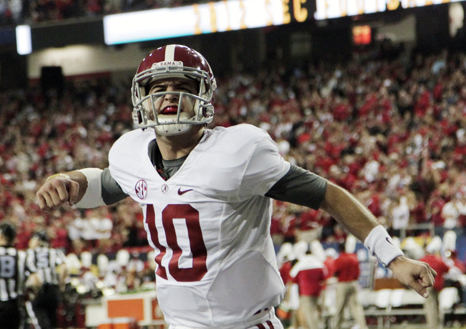 Photo - Alabama quarterback AJ McCarron (10) reacts after an Alabama field goal against Georgia during the first half of the Southeastern Conference championship NCAA college football game, Saturday, Dec. 1, 2012, in Atlanta. (AP Photo/Jamie Martin)