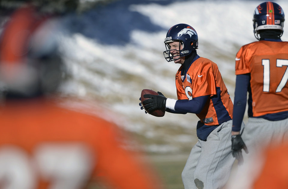Photo - Denver Broncos quarterback Peyton Manning (18) practices with the team at Dove Valley as they prepare for an NFL football game against the San Diego Chargers in the Divisional Round of the Playoffs on Jan. 6, 2014, in Englewood, Colo.  (AP Photo/The Denver Post, John Leyba) MAGS OUT; TV OUT; INTERNET OUT; NO SALES; NEW YORK POST OUT; NEW YORK DAILY NEWS OUT