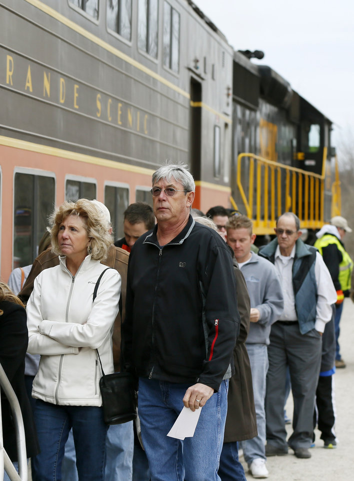 Photo - Passengers wait to board the train for a demonstration ride of the Eastern Flyer passenger train from Sapulpa to the Oklahoma City metro area, Sunday, Feb. 23, 2014. Photo by Nate Billings, The Oklahoman