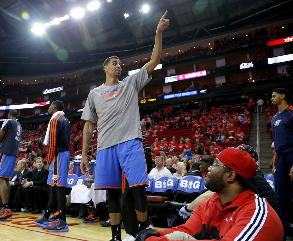 Photo - Oklahoma City's Thabo Sefolosha points to the scoreboard as he talks with the crowd during Game 6 in the first round of the NBA playoffs between the Oklahoma City Thunder and the Houston Rockets at the Toyota Center in Houston, Texas, Friday, May 3, 2013. Oklahoma City won 103-94. Photo by Bryan Terry, The Oklahoman