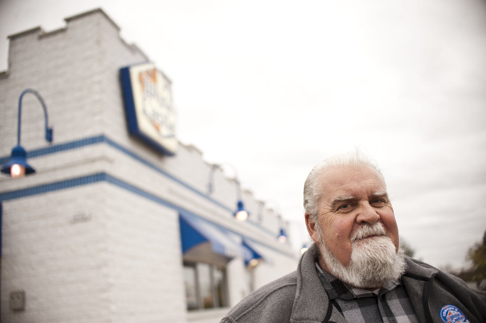 Photo - In this Oct. 29, 2012 photo, Jim Work poses outside of a White Castle restaurant in Flint, Mich. A quirky stunt a quarter-century ago and a 60-year relationship with a fast food chain has resulted in Jim Work, a suburban Detroit man's induction into White Castle hall of fame.  (AP Photo/The Flint Journal, Lauren Justice) LOCAL TV OUT; LOCAL INTERNET OUT