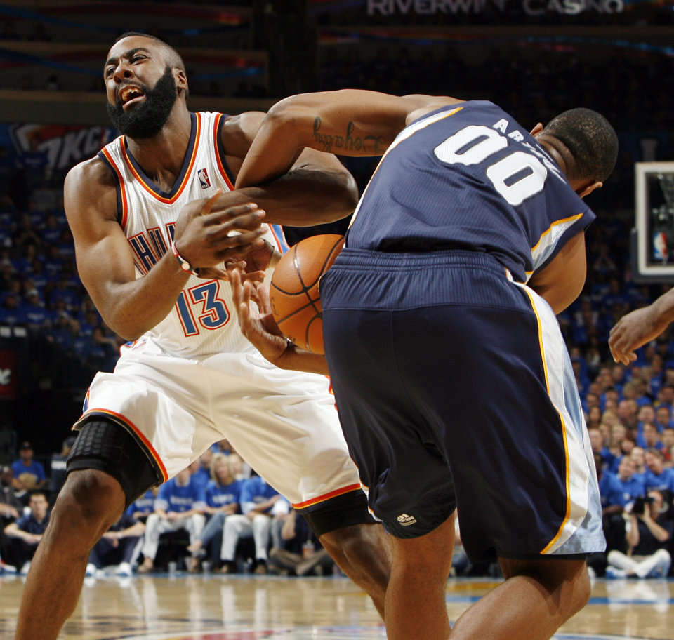 Photo - Darrell Arthur (00) of Memphis takes the ball from Oklahoma City's James Harden (13) in the first half during game one of the Western Conference semifinals between the Memphis Grizzlies and the Oklahoma City Thunder in the NBA basketball playoffs at Oklahoma City Arena in Oklahoma City, Sunday, May 1, 2011. Photo by Nate Billings, The Oklahoman