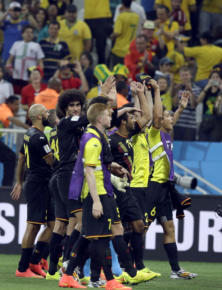 Photo - Belgium players wave to supporters following Belgium's 1-0 victory over South Korea to Belgium during the group H World Cup soccer match between South Korea and Belgium at the Itaquerao Stadium in Sao Paulo, Brazil, Thursday, June 26, 2014. (AP Photo/Thanassis Stavrakis)