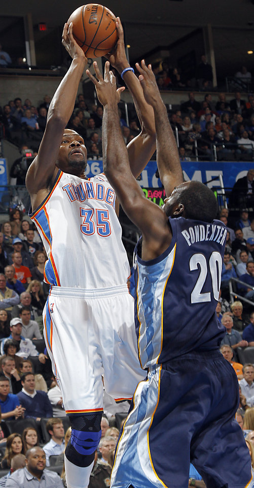 Photo - Oklahoma City's Kevin Durant (35) shoots over Memphis' Quincy Pondexter (20)  during the NBA basketball game between the Oklahoma City Thunder and the Memphis Grizzlies at Chesapeake Energy Arena on Wednesday, Nov. 14, 2012, in Oklahoma City, Okla.   Photo by Chris Landsberger, The Oklahoman