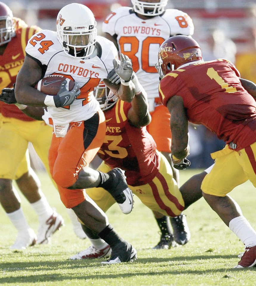 Photo - OSU's hiring of a pass-happy offensive coordinator doesn't mean OSU fans should expect running back Kendall Hunter to slow down. PHOTO BY BRYAN TERRY,  THE OKLAHOMAN