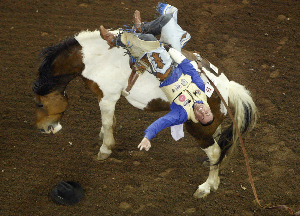 Wyatt Hancock of Yaylor, Ariz., competes in bareback riding during the PRCA National Circuit Finals Rodeo at the State Fair Arena on Friday, March 30, 2012. Photo by Bryan Terry, The Oklahoman
