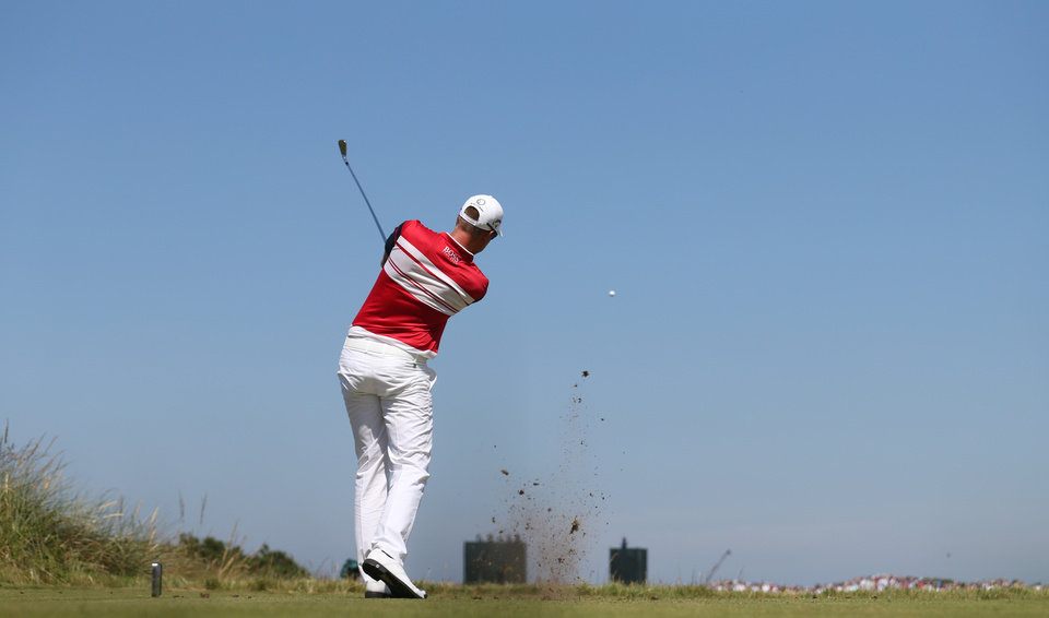 Photo - Henrik Stenson of Sweden plays a shot off the 13th tee during the first day of the British Open Golf championship at the Royal Liverpool golf club, Hoylake, England, Thursday July 17, 2014. (AP Photo/Peter Morrison)