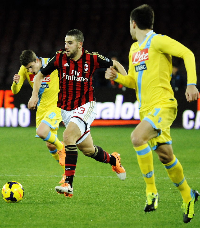Photo - AC Milan's Adel Taarabt, center, runs with the ball during a Serie A soccer match between Napoli and Milan, at the San Paolo stadium in Naples, Italy, Saturday, Feb. 8, 2014. (AP Photo/Salvatore Laporta)