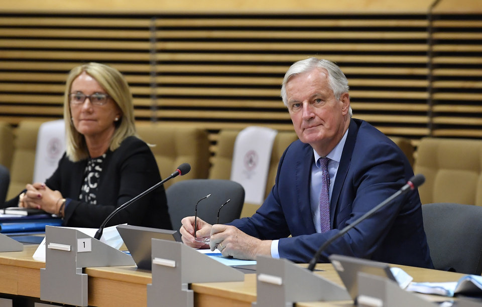 Photo -  European Union's Brexit negotiator Michel Barnier, right, waits for the start of a meeting on further Brexit negotiations at EU headquarters in Brussels, Monday, June 29, 2020. European Union and U.K. negotiators resumed in-person talks on a post-Brexit trade deal on Monday, with both sides insisting that the process must accelerate markedly if they're to reach an agreement by the end of the year. (John Thys, Pool Photo via AP)