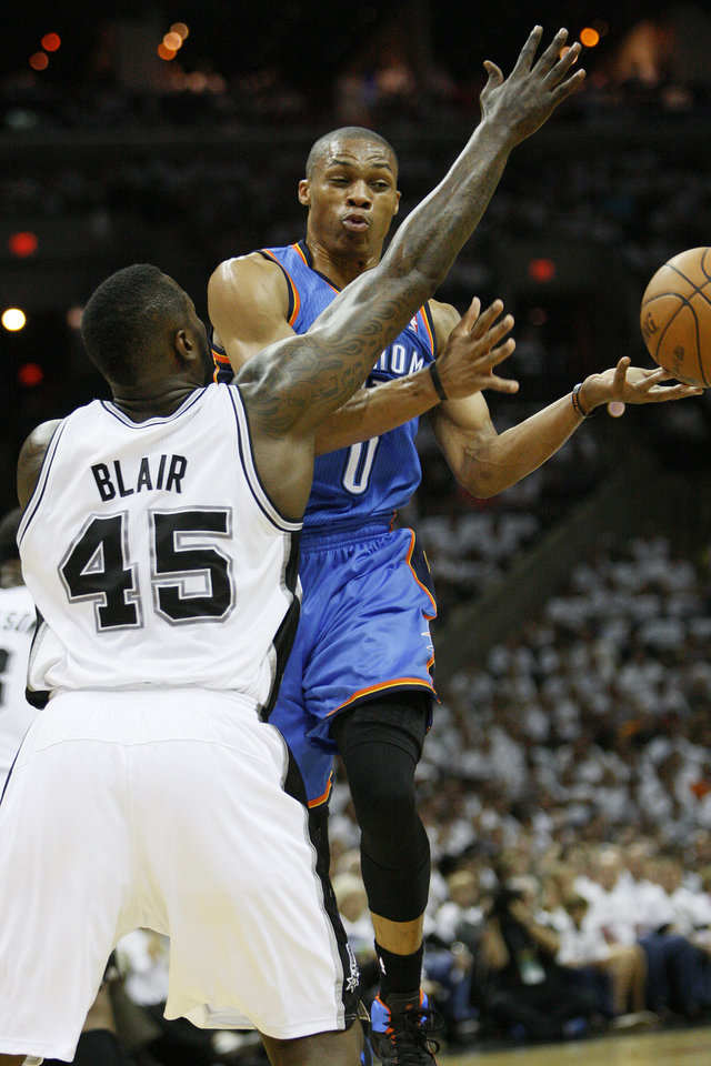 Photo - Oklahoma City's Russell Westbrook (0) passes the ball around San Antonio's DeJuan Blair (45) during Game 5 of the Western Conference Finals between the Oklahoma City Thunder and the San Antonio Spurs in the NBA basketball playoffs at the AT&T Center in San Antonio, Monday, June 4, 2012. Photo by Nate Billings, The Oklahoman