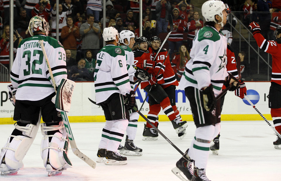 Photo - New Jersey Devils right wing Michael Ryder is congratulated by teammate New Jersey Devils center Travis Zajac (19) after scoring a goal against Dallas Stars goalie Kari Lehtonen (32), of Finland, during the second period of an NHL hockey game Thursday, Jan. 9, 2014, in Newark, N.J. (AP Photo/Adam Hunger)