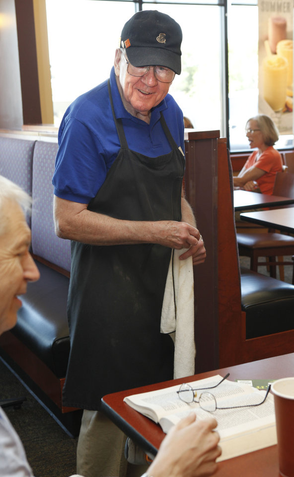 Cooper Parker, 74, speaks to patron Ray Summers as he works as a dining room attendant at Panera Bread in Nichols Hills, OK, Friday, July 20, 2012,  By Paul Hellstern.  The Oklahoman