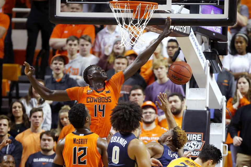 Photo - Oklahoma State's Yor Anei (14) defends during an NCAA basketball game between the Oklahoma State University Cowboys (OSU) and the Oral Roberts Golden Eagles (ORU) at Gallagher-Iba Arena in Stillwater, Okla., Wednesday, Nov. 6, 2019. Oklahoma State won 80-75. [Bryan Terry/The Oklahoman]