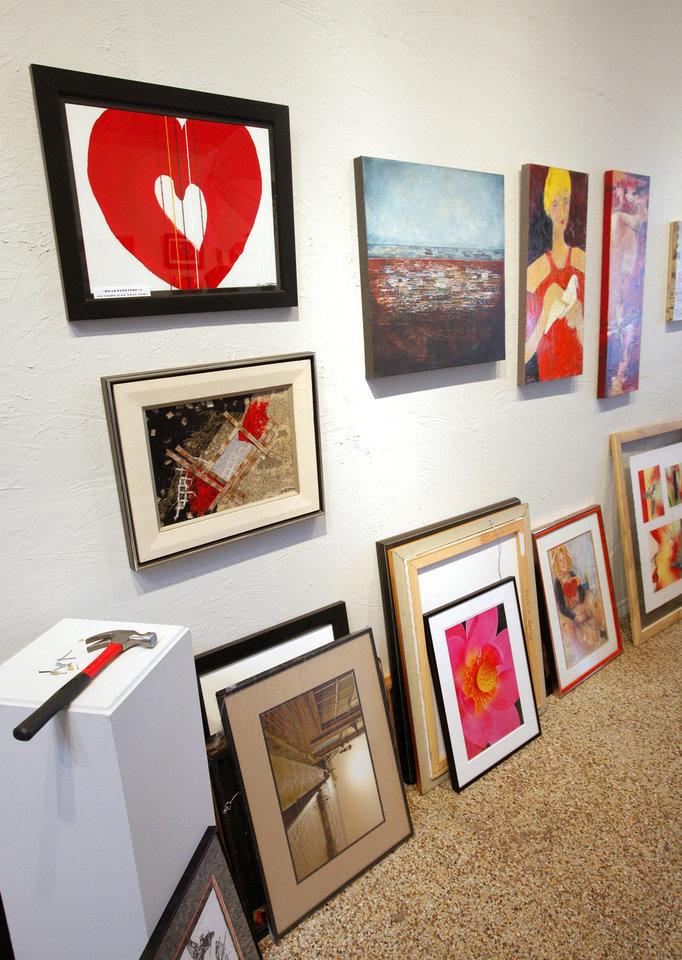 Photo - The Paseo Arts District has teamed up with Oklahoma Heart Hospital to help raise awareness of heart disease. PhotoS by Paul B. Southerland, The Oklahoman