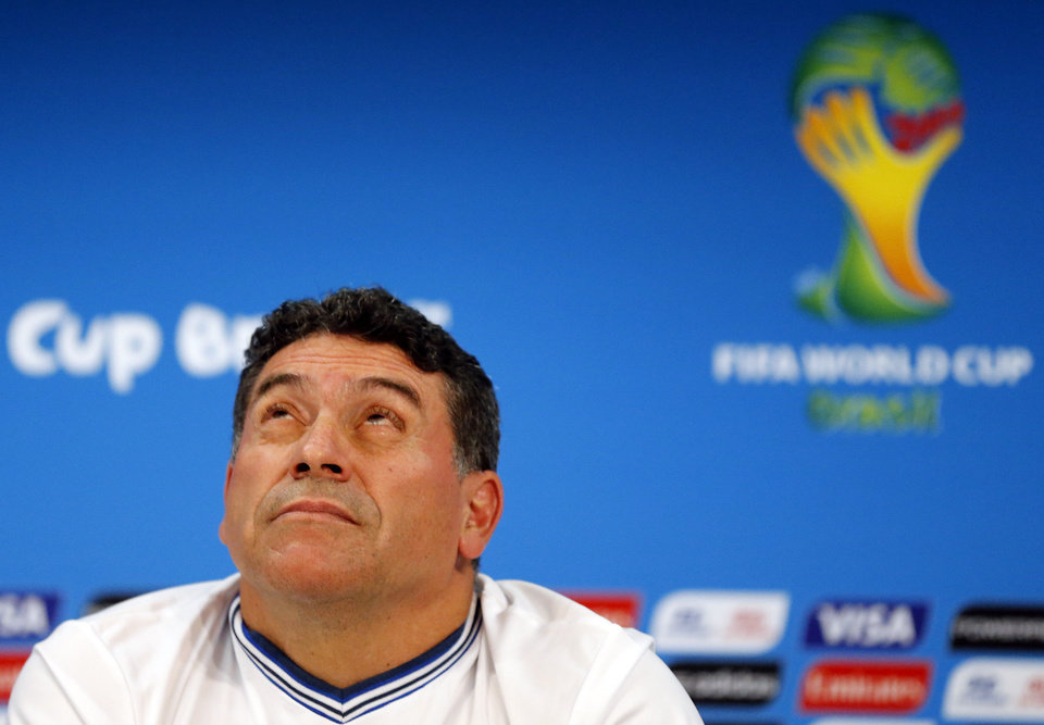 Photo - Hondura's head coach Luis Suarez looks up  during a press conference at the Arena da Amazonia in Manaus, Brazil, Tuesday, June 24, 2014, one day before the group E match between Honduras and Switzerland of the 2014 soccer World Cup. (AP Photo/Frank Augstein)