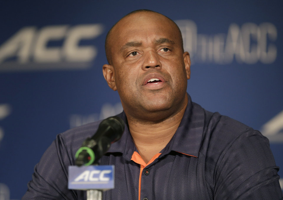 Photo - FILE - In this July 21, 2014, file photo, Virginia head coach Mike London answers a question during a news conference at the Atlantic Coast Conference Football kickoff in Greensboro, N.C. Coaches often say they are always on the hot seat. That might be true, but some seats are hotter than others. A few coaches in high-profile positions heading into 2014 very much in need of winning records and quality victories. (AP Photo/Chuck Burton, File)