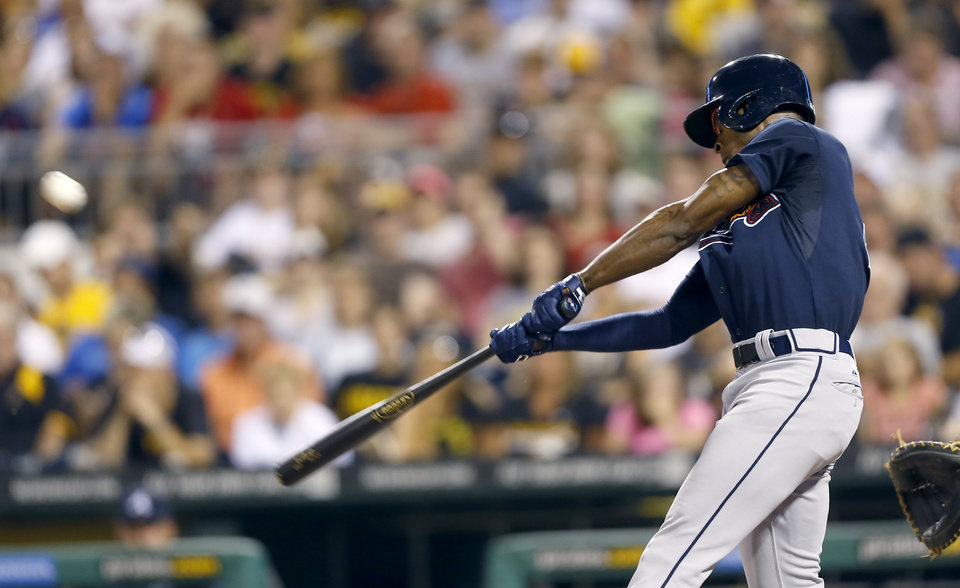 Photo - Atlanta Braves' B.J. Upton hits a single to right field driving in Chris Johnson in the fifth inning of a baseball game on Tuesday, Aug. 19, 2014, in Pittsburgh. (AP Photo/Keith Srakocic)