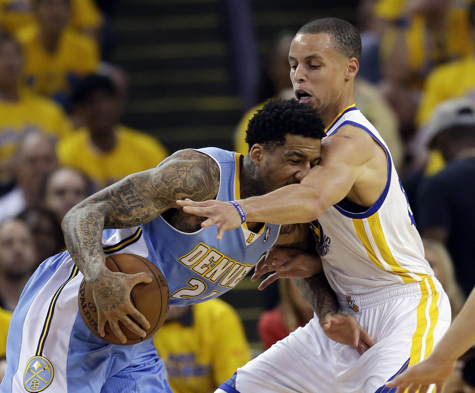 Denver Nuggets' Wilson Chandler, left, drives against Golden State Warriors' Stephen Curry during the first half of Game 6 in a first-round NBA basketball playoff series in Oakland, Calif., Thursday, May 2, 2013. (AP Photo/Marcio Jose Sanchez)