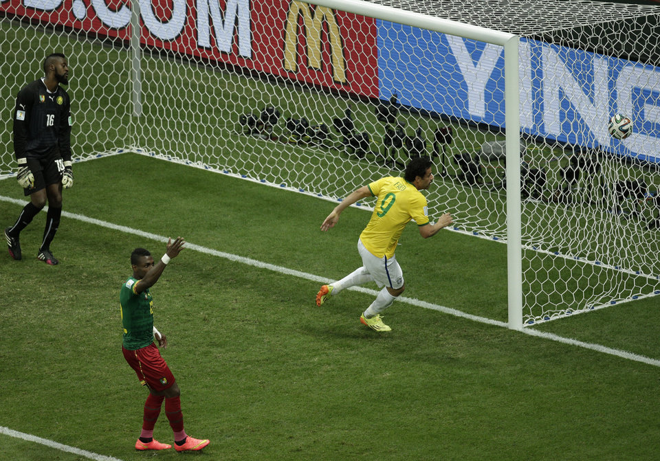 Photo - Brazil's Fred scores his side's 3rd goal during the group A World Cup soccer match between Cameroon and Brazil at the Estadio Nacional in Brasilia, Brazil, Monday, June 23, 2014. (AP Photo/Christophe Ena)