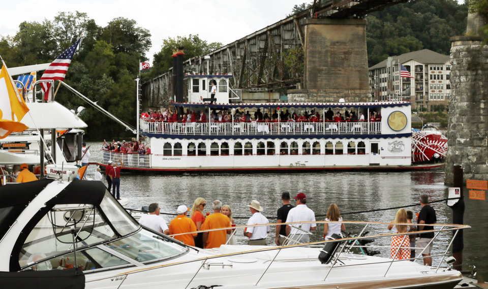 Photo - A boat full of OU fans cruises the Tennessee River before the college football game between the Oklahoma Sooners and the Tennessee Volunteers at Neyland Stadium in Knoxville, Tennessee, Saturday, Sept. 12, 2015. Photo by Nate Billings, The Oklahoman