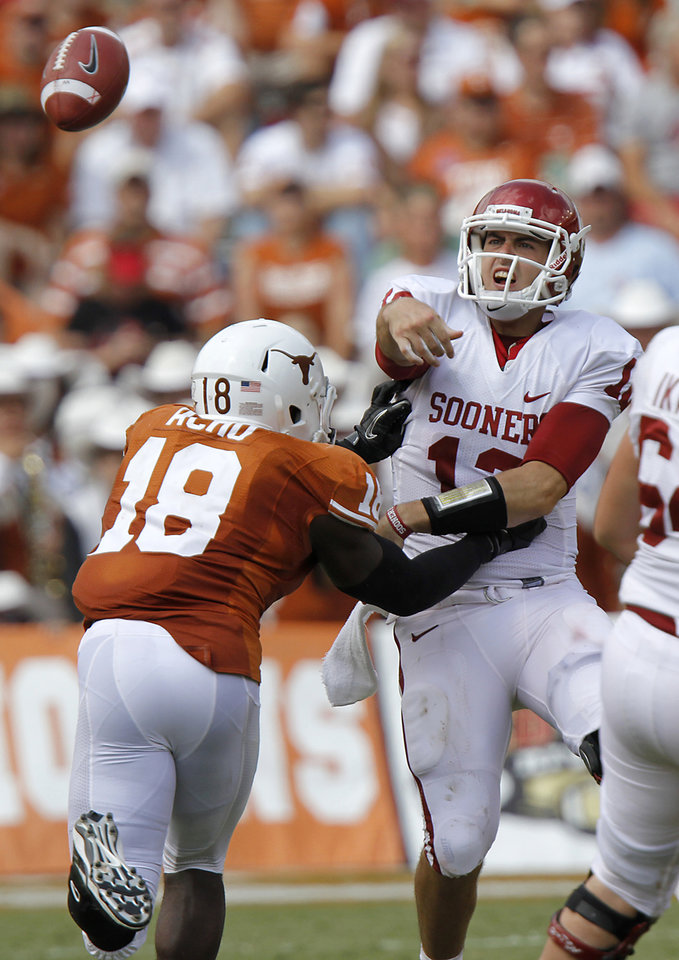 Oklahoma's Landry Jones (12) is rushed by Texas' Emmanuel Acho (18) on a pass attempt during the Red River Rivalry college football game between the University of Oklahoma Sooners (OU) and the University of Texas Longhorns (UT) at the Cotton Bowl in Dallas, Saturday, Oct. 8, 2011. Photo by Chris Landsberger, The Oklahoman