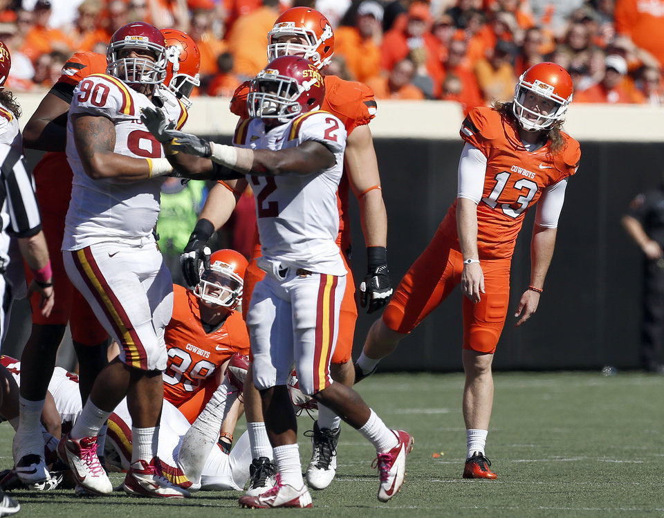 Photo - Oklahoma State's Quinn Sharp (13) reacts after missing a 51-yard field goal attempt during a college football game between Oklahoma State University (OSU) and Iowa State University (ISU) at Boone Pickens Stadium in Stillwater, Okla., Saturday, Oct. 20, 2012. Photo by Sarah Phipps, The Oklahoman