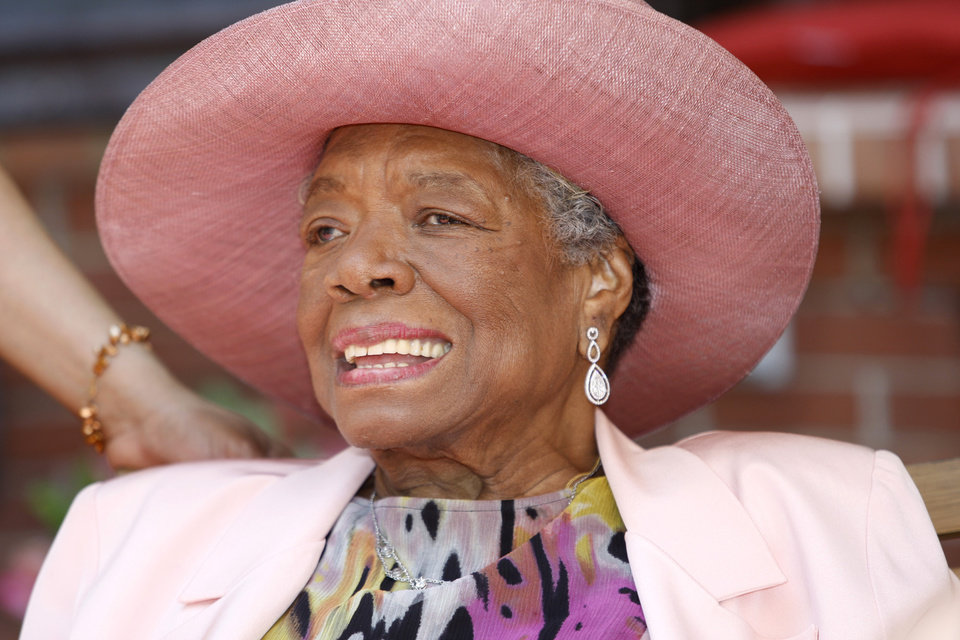 Photo - FILE - In this May 20, 2010, file photo, author Maya Angelou socializes during a garden party at her home in Winston-Salem, N.C. Angelou, author of