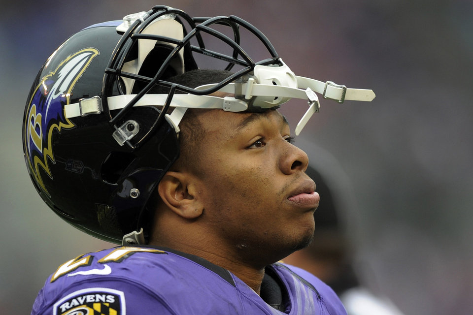 Photo - Baltimore Ravens running back Ray Rice looks up at the scoreboard during the first half of an NFL football game against the Denver Broncos in Baltimore, Sunday, Dec. 16, 2012. (AP Photo/Nick Wass)