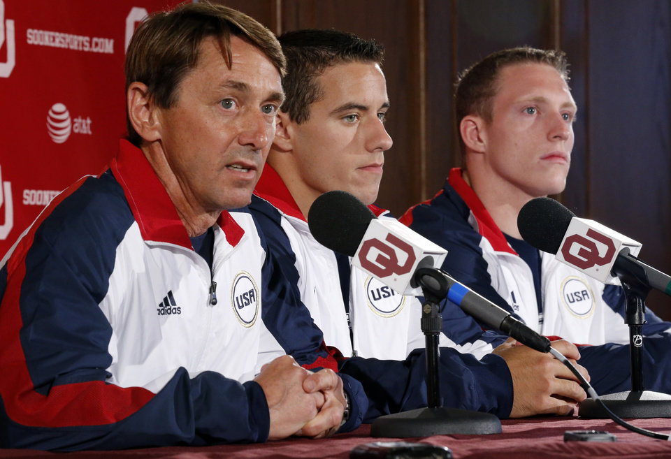 Photo - Sooner gymnastics coach Mark Williams speaks during a press conference on Thursday, July 5, 2012 in Norman, Okla.   Gymnasts Jake Dalton (center) and Steven Legendre (right) are among six athletes from the University of Oklahoma who have qualified for the 2012 London Olympics in track and field, wrestling and men's gymnastics.  Photo by Steve Sisney, The Oklahoman