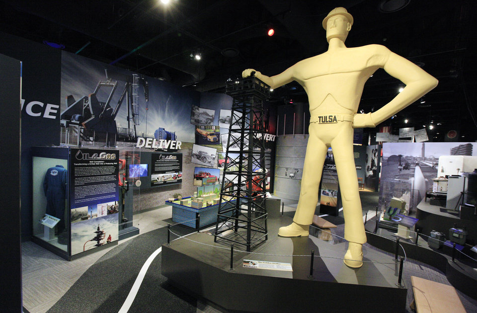 Photo - A 15-foot-tall reproduction of Tulsa's Golden Driller statue is part of the new oil and gas exhibit
