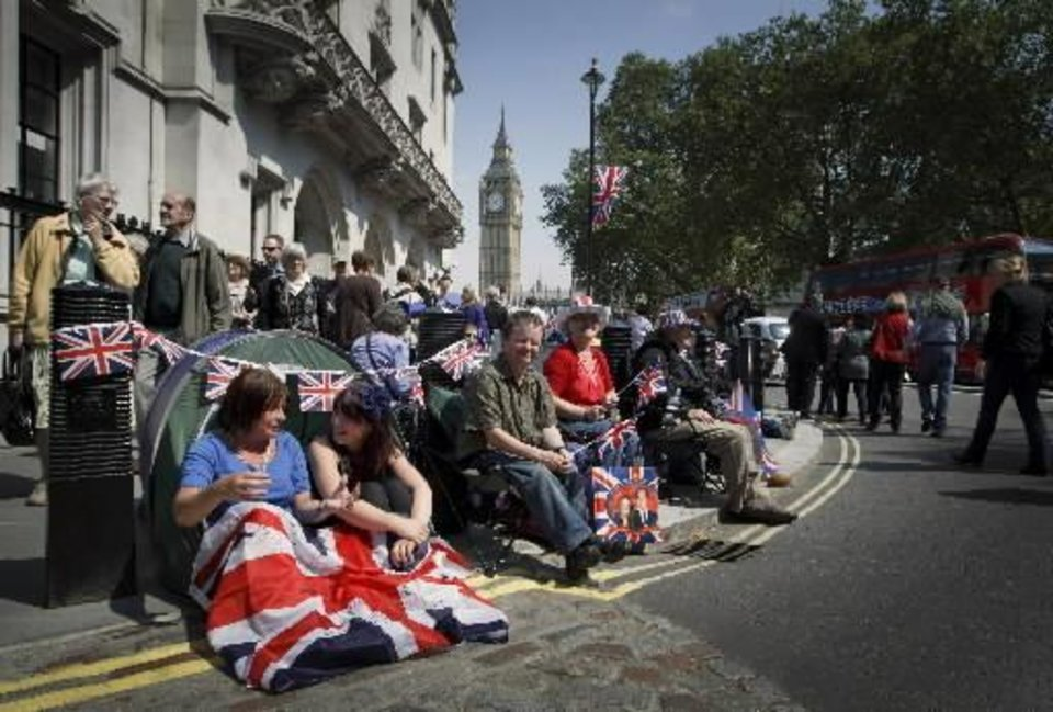 Photo -  Royal enthusiasts camp in front of Westminster Abbey in London, Thursday, April 28, 2011. Revelers are camping outside the Abbey where Prince William and Kate Middleton are due to get married on Friday, April 29. (AP Photo/Daniel Ochoa de Olza)