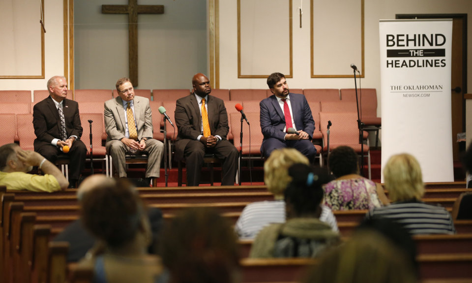 Photo - From left, Oklahoma County District Attorney David Prater, Oklahoma City Police Chief Bill Citty, the Rev. Lawrence Ware, and Brady Henderson, legal affairs director for the American Civil Liberties Union of Oklahoma, listen to questions during a public forum about unsolved homicides hosted by The Oklahoman at Prospect Baptist Church in Oklahoma City, Tuesday, July 26, 2016. Photo by Bryan Terry, The Oklahoman