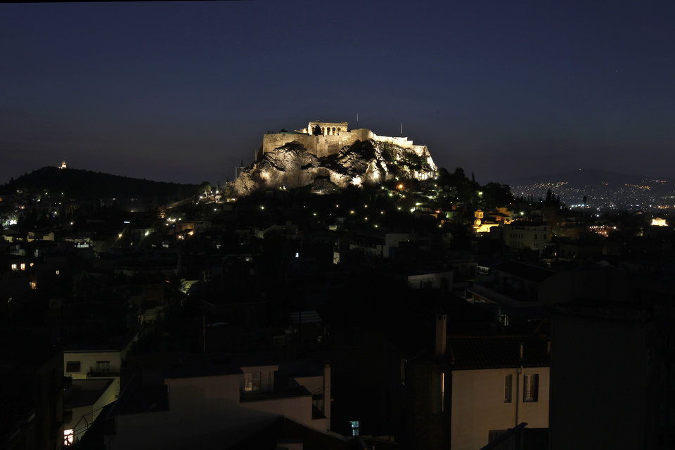 A general view of the city of Athens, with the ancient Acropolis hill, Tuesday, Nov. 1, 2011. Markets plunged Tuesday and Greece\'s beleaguered Socialist government faced collapse, a day after Prime Minister George Papandreou unexpectedly announced plans to hold a referendum on the latest international debt relief and bailout deal for his country. (AP Photo/Petros Giannakouris) ORG XMIT: ATH110
