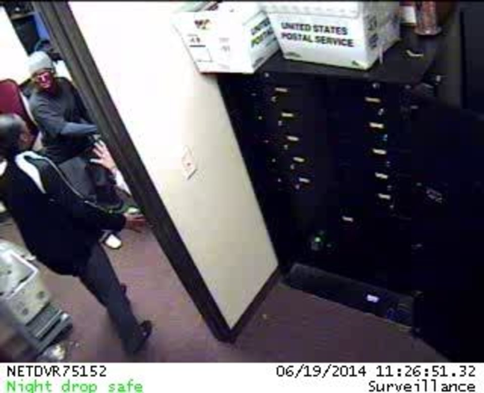 Photo -  Surveillance photo of a bank robbery Thursday at IBC Bank, 5701 N May Ave., in Oklahoma City. Provided by the FBI
