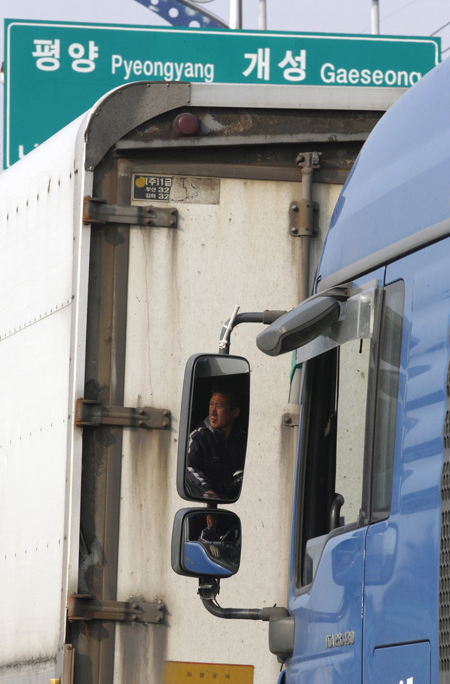 Photo - A South Korean truck driver waits to head the North Korea's city of Kaesong, at the customs, immigration and quarantine office in Paju, South Korea, near the border village of Panmunjom, Thursday, April 4, 2013. North Korea on Wednesday barred South Korean workers from entering a jointly run factory park just over the heavily armed border in the North, officials in Seoul said, a day after Pyongyang announced it would restart its long-shuttered plutonium reactor and increase production of nuclear weapons material. (AP Photo/Ahn Young-joon)