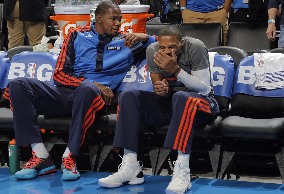Photo - Oklahoma City's Kevin Durant (35) and Russell Westbrook (0) joke around on the bench in pre game during the NBA basketball game between the Oklahoma City Thunder and the Dallas Mavericks at Chesapeake Energy Arena in Oklahoma City, Okla. on Wednesday, Nov. 6, 2013.  PHOTO BY CHRIS LANDSBERGER, The Oklahoman