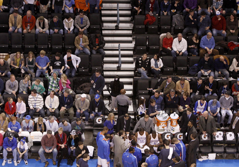 Photo - A sparse crowd watches during the NBA basketball game between the Oklahoma City Thunder and the New Orleans Hornets, Wednesday, Feb. 2, 2011 at the Oklahoma City Arena. Photo by Bryan Terry, The Oklahoman