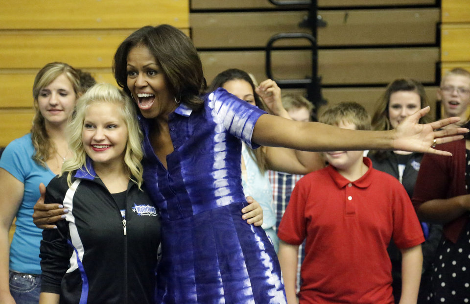 Photo - First Lady Michelle Obama poses for a picture with a student at an event at Watertown High School to encourage people to drink more water, Thursday, Sept. 12, 2013, in Watertown, Wis. (AP Photo/Morry Gash)