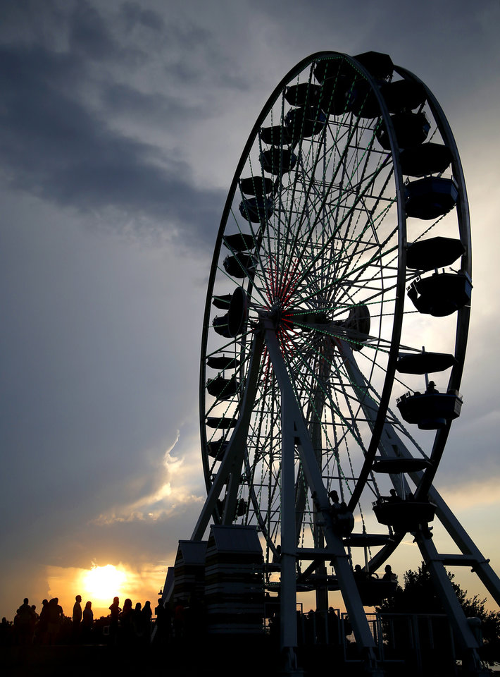 Photo -  The sun sets behind the Wheeler Ferris wheel in Oklahoma City, Thursday, June 30, 2016. Photo by Bryan Terry, The Oklahoman