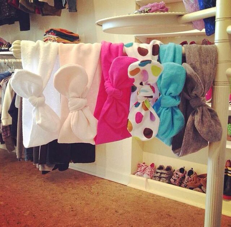 Photo - This undated photo provided by Brooke Sacco and posted in June 2014 to the Instagram account of her company, Behind the Moon, a shop that sells used and new kids clothing in Hammonton, N.J., shows Jersey top knot headbands by plumTango. (AP Photo/Courtesy Brooke Sacco)