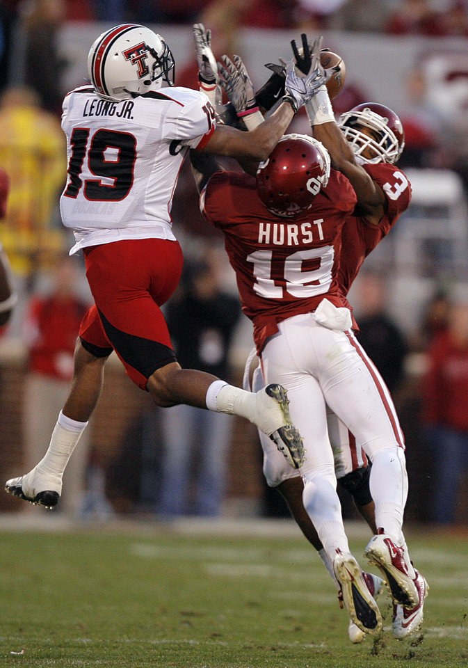 Oklahoma\'s Jonathan Nelson (3) and Demontre Hurst (19) break up a pass for Texas Tech\'s Lyle Leong (19) that Nelson intercepted during the second half of the college football game between the University of Oklahoma Sooners (OU) and the Texas Tech Red Raiders (TTU) at the Gaylord Family Memorial Stadium on Saturday, Nov. 13, 2010, in Norman, Okla. Photo by Chris Landsberger, The Oklahoman