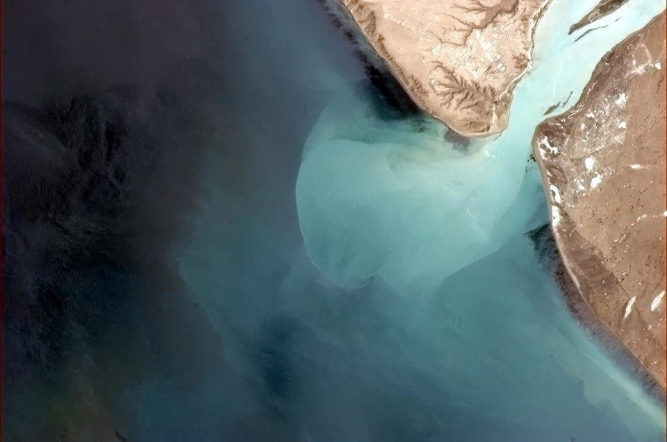 "This photo taken from the International Space Station in orbit above earth by Canadian astronaut Col. Chris Hadfield, as posted on Facebook, shows ""glacial water burping into the Atlantic in deep Southern Argentina,"" as he noted. <strong></strong>"